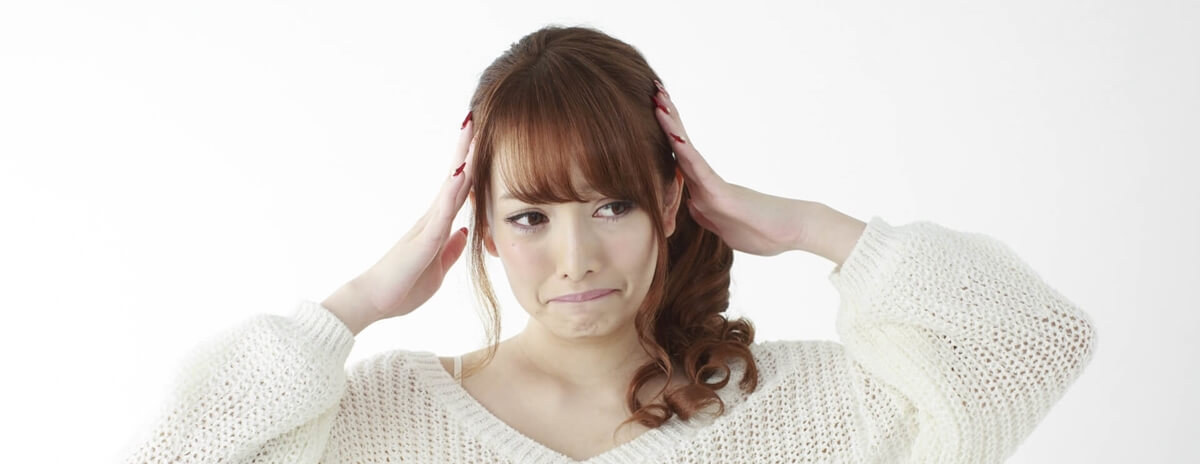 「失敗、NG、悩み」の女性イメージ画像